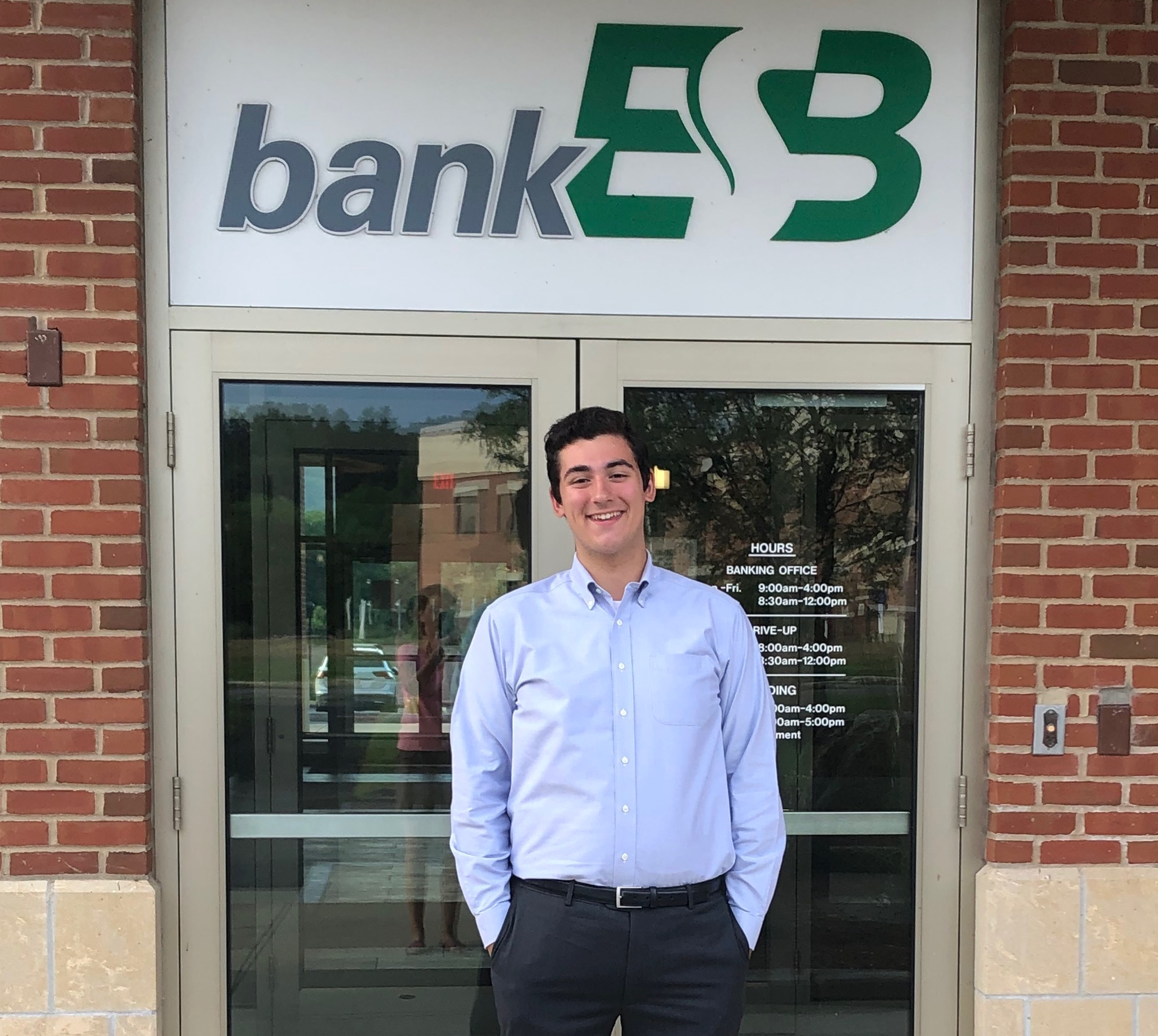Student In front of Bank